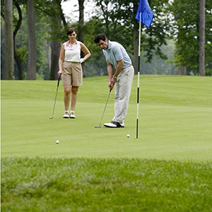 man and lady on the golf course